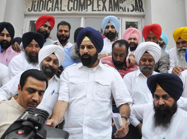 Punjab revenue minister Bikram Singh Majithia along with party workers coming out of the court complex in Amritsar on Friday.