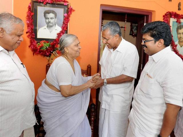 In this file photo, CPI(M) leader Pinarayi Vijayan (centre) can be seen visiting the house of a party leader.