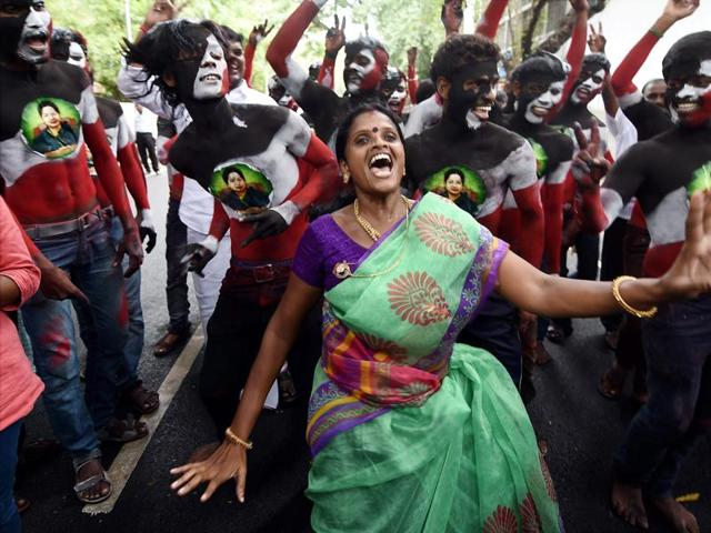 AIADMK supporters celebrate after winning the Tamil Nadu election outside their party office in Chennai.