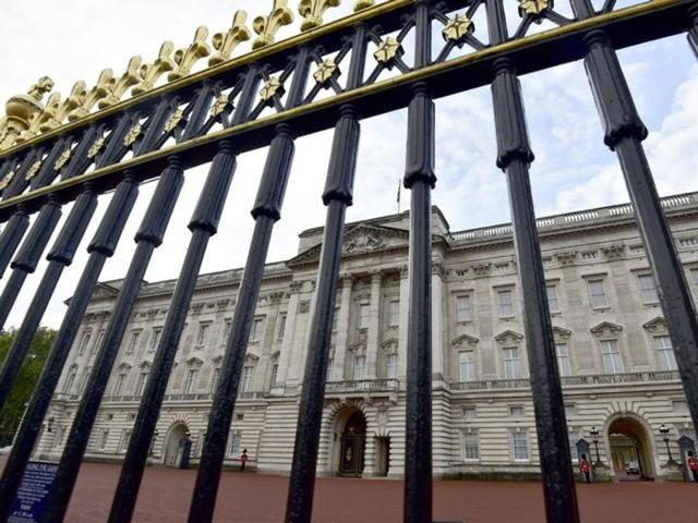 Buckingham Palace is seen through the perimeter fence in central London.
