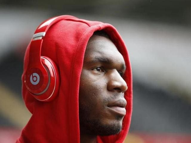 Liverpool manager Jurgen Klopp speaks to Christian Benteke before he comes on as a substitute during the Europa League semifinal, second leg against Villareal.