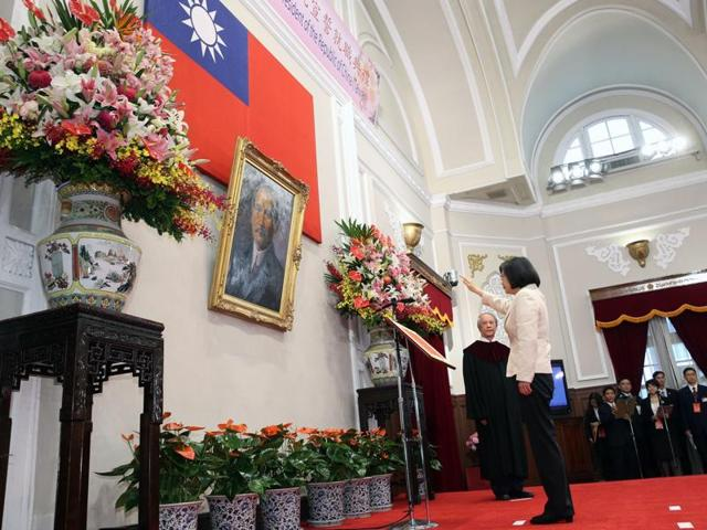 Taiwan's new President Tsai Ing-wen (left) and vice president Chen Chien-jen wave during their inauguration ceremonies in Taipei on Friday.
