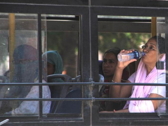 Women cover their faces to get respite from heat in Indore on Thursday.