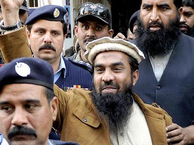 Zaki-ur-Rahman Lakhvi, the main suspect of the Mumbai terror attacks in 2008, raises his fist after his court appearance in Islamabad.