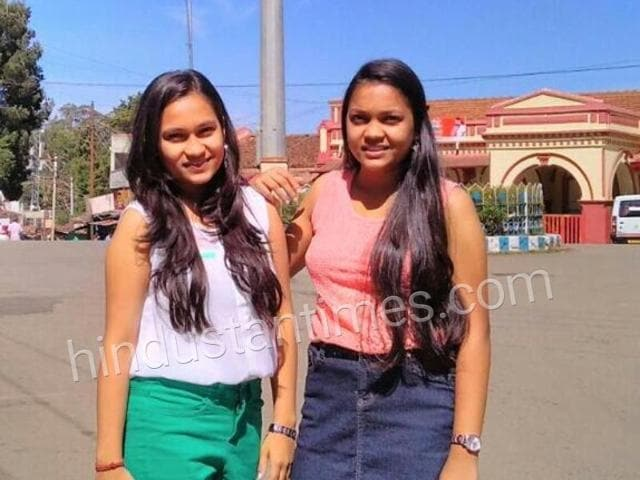 Twin sisters Ankita Chauhan (orange top) and Harshita Chauhan (white top), who have scored identical marks in CBSE exams.