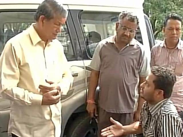 Uttarakhand chief minister Harish Rawat meets one of the injured from the mob attack at a temple. BJP MP Tarun Vijay was attacked after visiting the temple with Dalit BSP leader Daulat Kunwar.