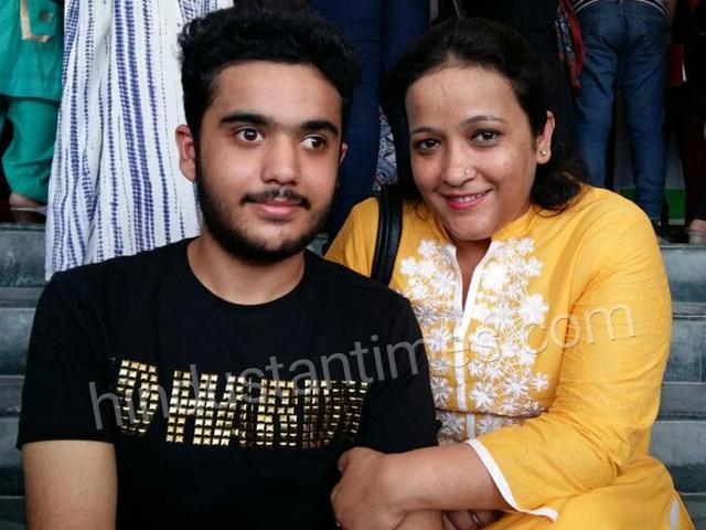 Rakshit Malik with his mother Rachna Malik after the CBSEresults were announced on Saturday.