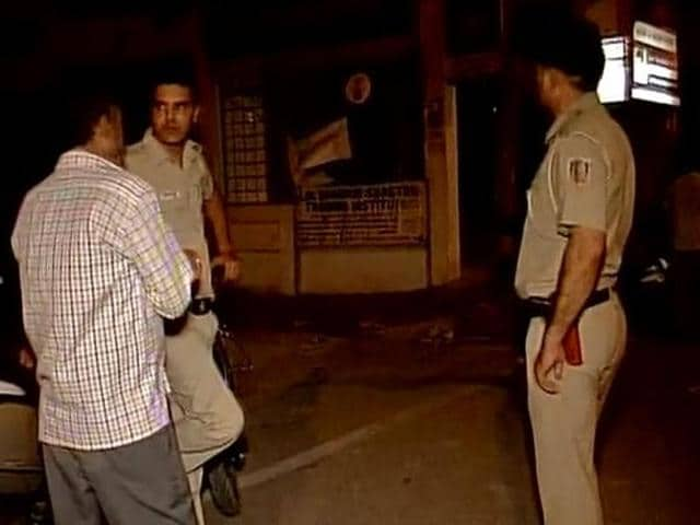 Police officers investigate the murder of a 23-year-old African national in Vasant Kunj.
