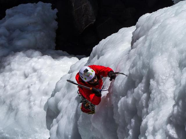 Climber Abhijeet Singh scaling the frozen waterfall.