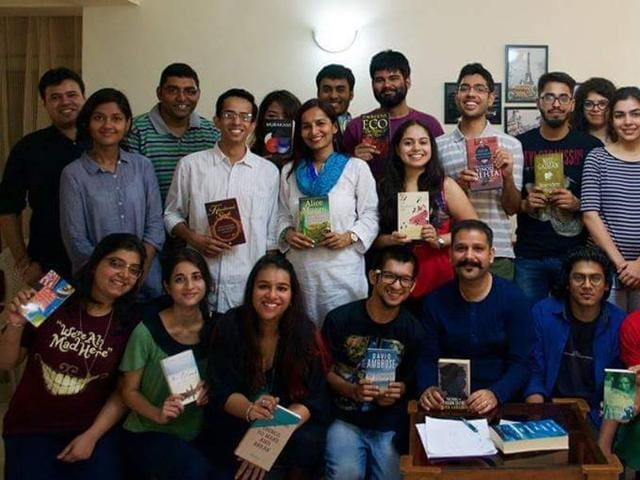 Members of Delhi BYOB (Bring Your Own Book) club engrossed in a reading session.