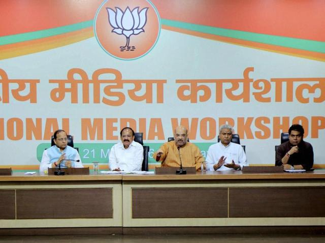 BJP president Amit Shah with Union minister Venkiah Naidu and party leader Ram Lal at the BJP National Media Workshop in New Delhi.