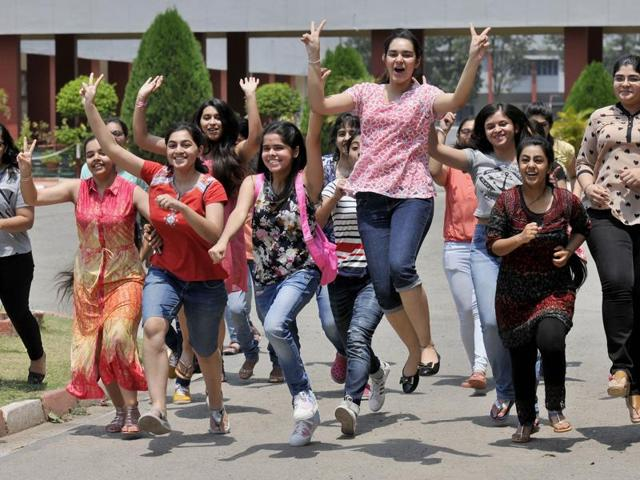 The students of Sacred Heart celebrating their success in the school campus after the declaration of CBSE Class 12 results in Chandigarh on Saturday.