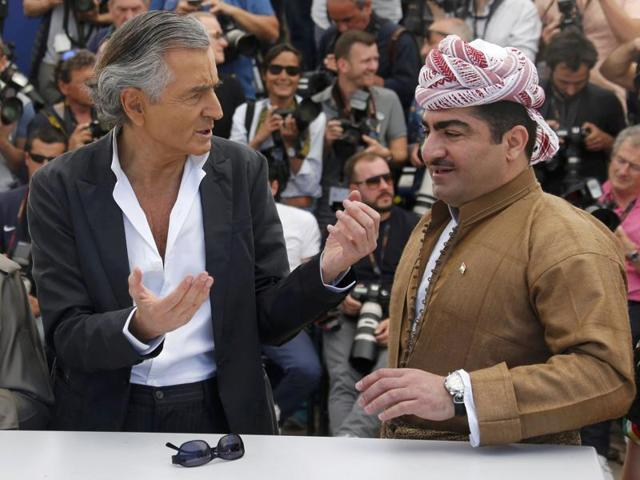 French philosopher, writer and director Bernard-Henri Levy poses with Kurdish Major General Serwan Sabir Barzani (3rdL) and Kurdish Lieutenant-General Mustafa Ali Jaafar (2ndL) during a photocall for the film Peshmerga at Cannes.
