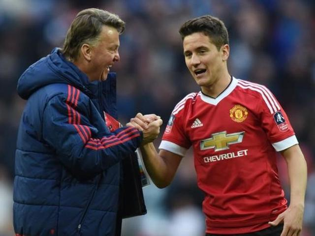 Manchester United's Ander Herrera and manager Louis van Gaal after the game.