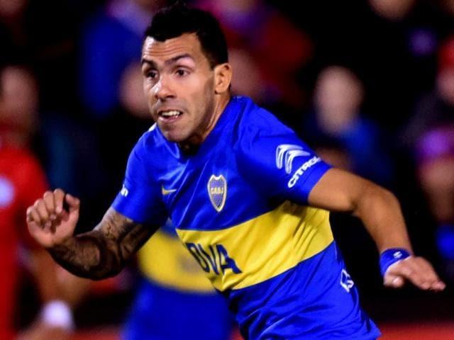 Argentina's Boca Juniors player Carlos Tevez celebrates after scoring against Paraguay.