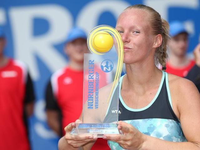Dutch tennis player Kiki Bertens celebrates with the trophy after her win against Colombian Mariana Duque-Marino in the final of the WTA tennis tournament in Nuremberg, Germany, on May 21, 2016.