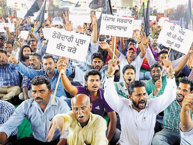 Municipal corporation workers protesting near the bus stand in Patiala on Friday.