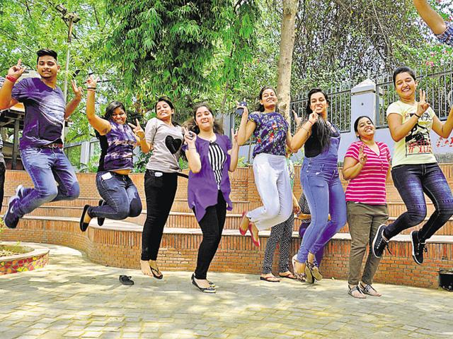 Students celebrate their success in the CBSE class 12th results in Gurgaon on Saturday.