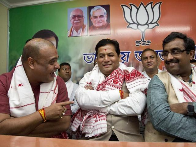 Bharatiya Janata Party's Sarbananda Sonowal (centre), during a meeting with other leaders at the party's office in Guwahati on Friday.