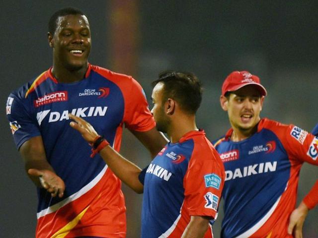 Delhi Daredevils players Carlos Brathwaite and Amit Mishra celebrate after their win.