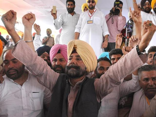 Former Congress leader Jagmeet Singh Brar with his supporters at a rally in Chappar Chirri near SAS Nagar (Mohali) on Saturday.