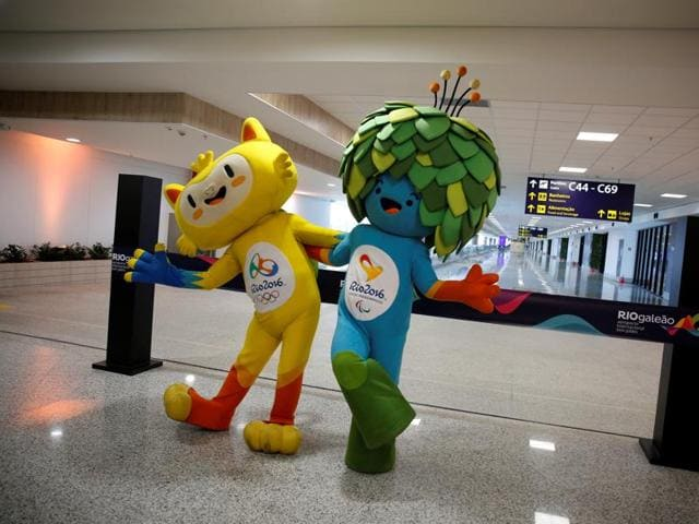 Olympic and Paralympic Games mascots Vinicius (L) and Tom pose during the opening ceremony of the new terminal at the international airport Galeao, which is expected to receive 1.5 million passengers during the 2016 Rio Olympics.