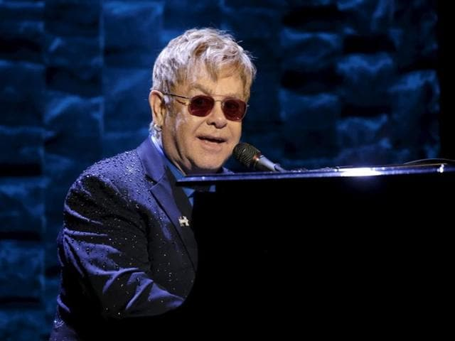 Singer Elton John says he doesn't want to miss out on his children growing up.