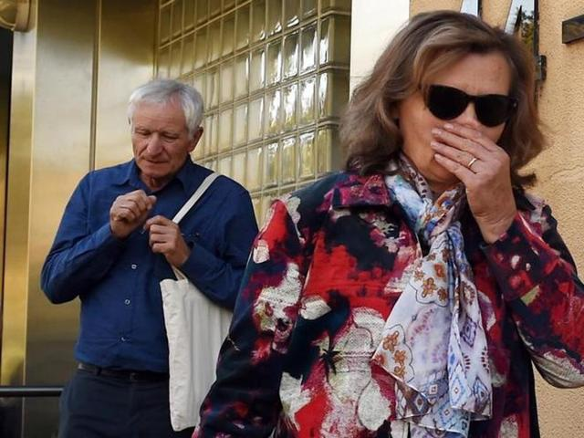 The parents of a victim from Malaysian Airlines Flight MH17 react as they leave the State Coroners Court, after the New South Wales State Coroner handed down his findings from an inquest into the deaths of six residents who were aboard the plane, in Sydney, Australia.