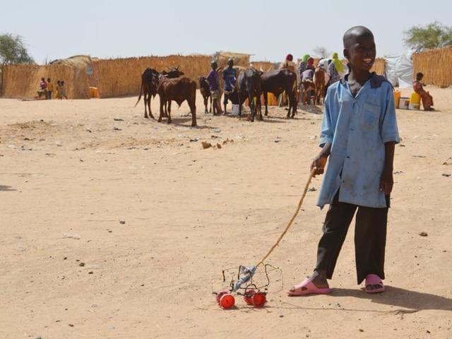 A child walks inside the Assaga refugee camp near Diffa in the southeast of Niger.