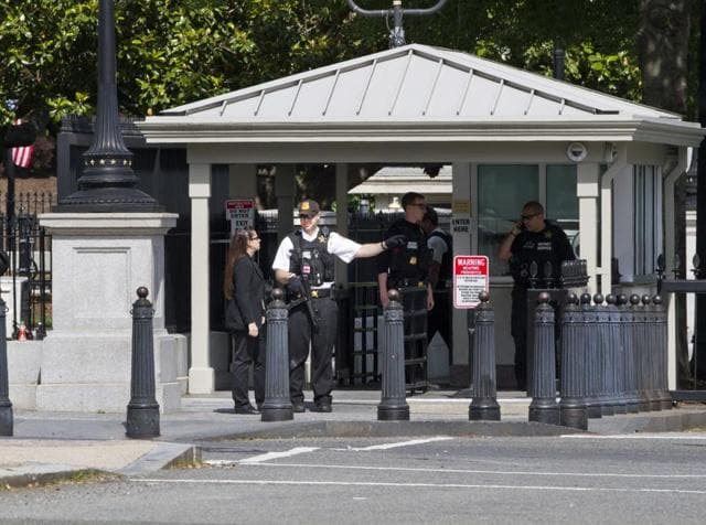 Secret service officers stand guard outside of the guard entrance on 17th St Northwest near the White House in Washington.
