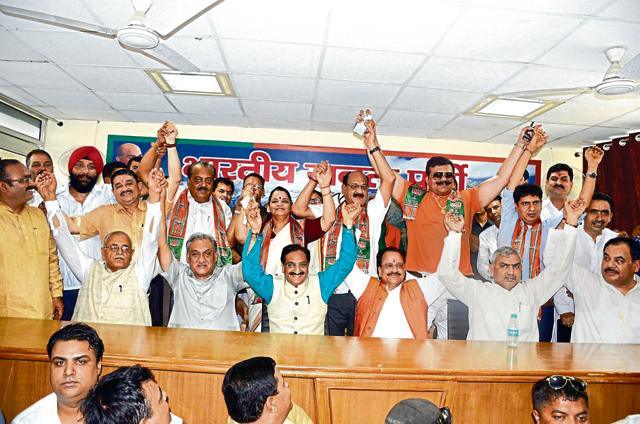 The nine former Congress legislators, who joined the BJP on May 18, at a formal welcome at the state BJP headquarters on Sunday.