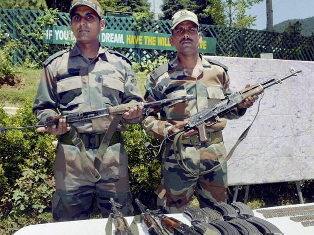 Army officers display the arms and ammunition recovered from the five militants who were killed in an encounter in J-K's Kupwara on May 21, 2016. One of the two army soldiers, injured in the  gunbattle, succumbed to his injuries on Sunday.