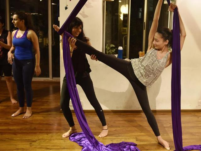 Trainer Lara Saluja conducts an aerial silks and anti-gravity yoga combination workout class in Mumbai.