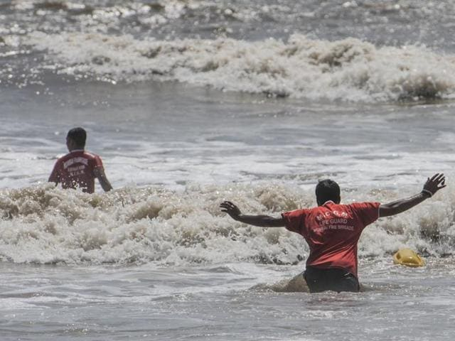 Lifeguards search for Abrail Gulam Mohammad Shaikh at Juhu on Sunday.