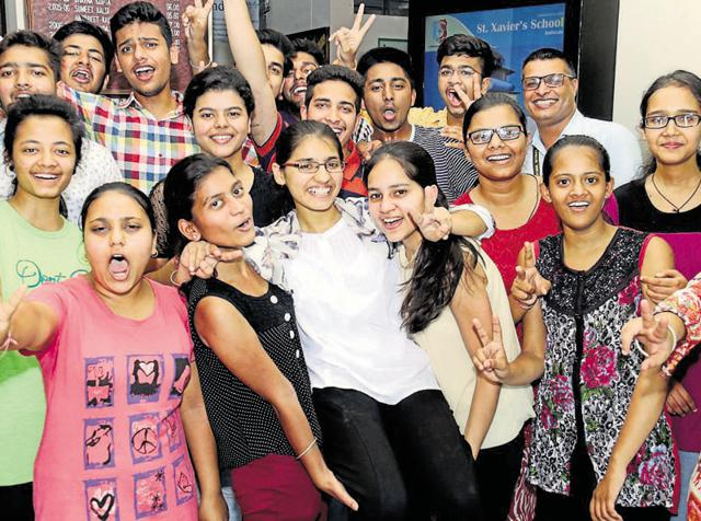 Students and staff of St Xavier's Convent celebrating after the CBSE declared Class-12 results, in Bathinda on Saturday.
