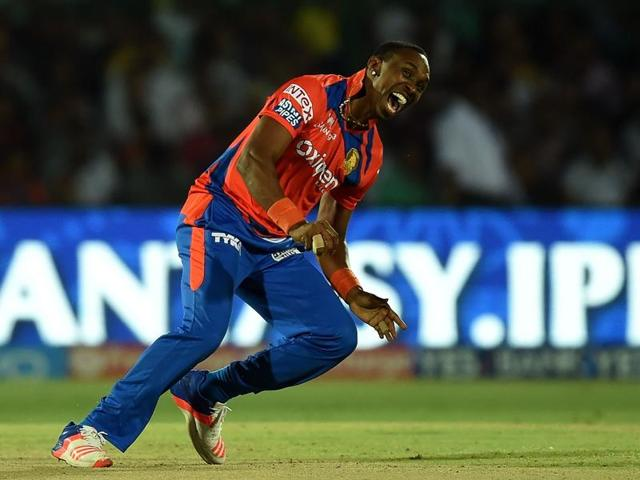 Dwayne Bravo celebrates the wicket of Jos Buttler during the match against Mumbai Indians in Kanpur on May 21, 2016.