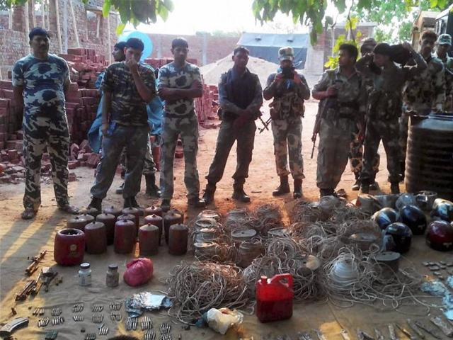 CRPF personnel with explosives recovered from the Latehar district of Jharkhand.