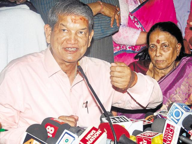 """File photo of Uttrakhand Chief Minister Harish Rawat (right).  The CBI on Sunday asked Rawat to appear before it on May 24 over a probe into an alleged """"sting"""" video involving him."""