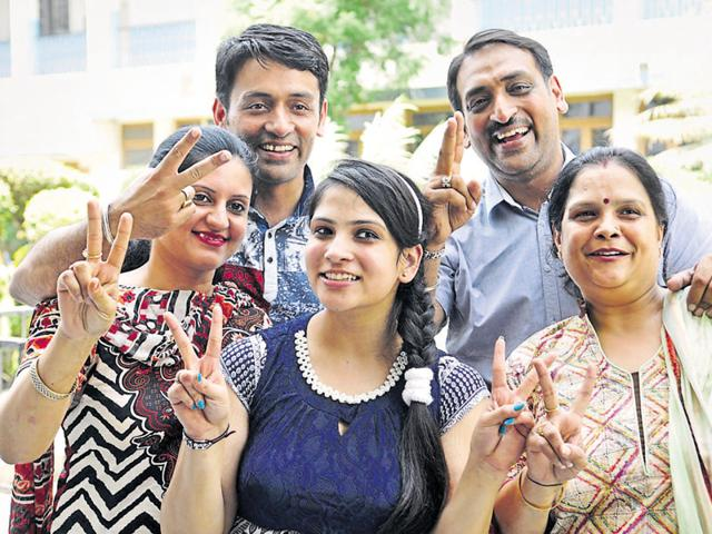 Anchal Jain with her family members in Jalandhar on Saturday.