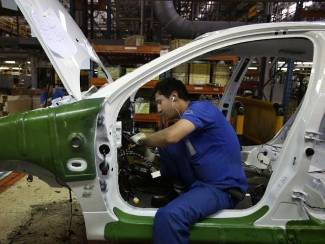 An Iranian car worker assembles a car at the state-run Iran Khodro automobile manufacturing plant just outside Tehran, Iran. Tata Motors is in talks with Iran Khodro to assemble its petrol cars in the country.