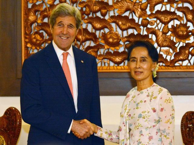 US Secretary of State John Kerry shakes hands with Myanmar's foreign minister Aung San Suu Kyi during their meeting in Myanmar's capital Naypyidaw on Sunday.