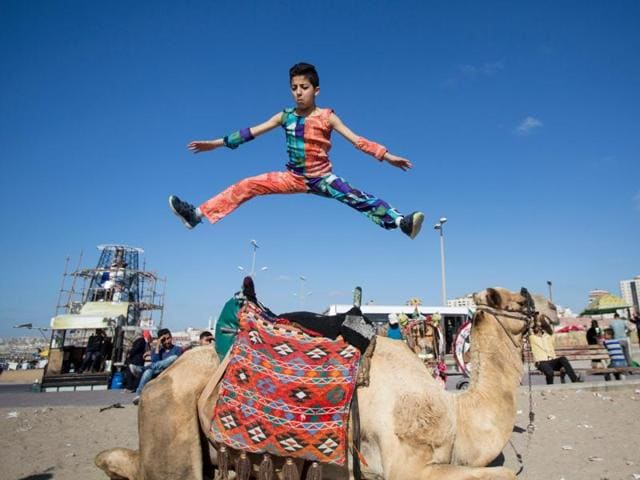 """Mohammed al Sheikh's antics earned this young Palestinian from the Gaza Strip the nickname of """"Spiderman""""."""