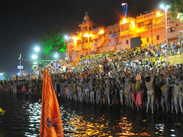 Naga sadhus and others take a holy dip in Kshipra river  on the occasion of last shahi snan in Ujjain on Saturday.