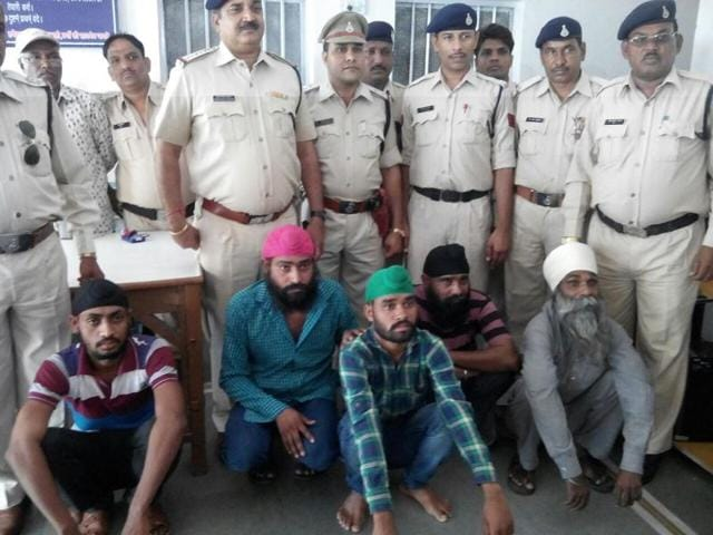 The accused in police custody in Dhar on Sunday.