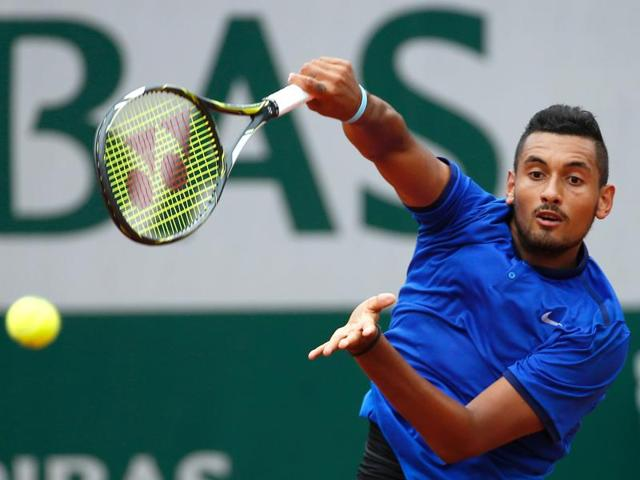 Australia's Nick Kyrgios returns the ball to Italy's Marco Cecchinato during their first round match at the 2016 French Open in Paris on May 22, 2016.