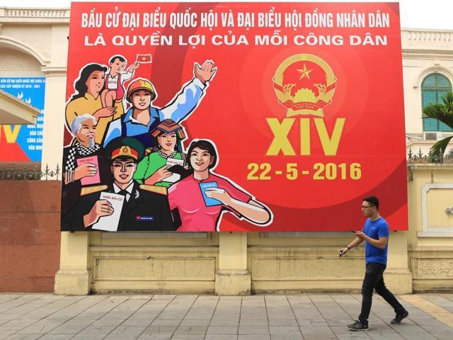 A man walks pass a billboard of Vietnam's Parliamentary Election in Hanoi, Vietnam on Sunday.