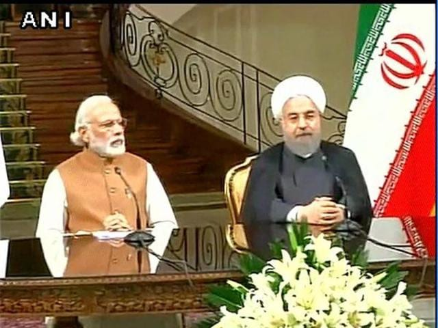PM Narendra Modi and Iranian President Hassan Rouhani deliver joint statement in Tehran.