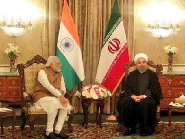 PM Narendra Modi meets with Iranian President Hassan Rouhani in Tehran.