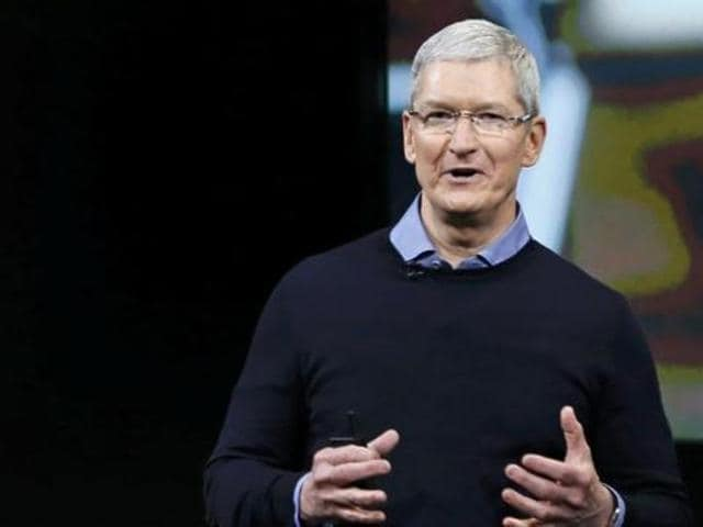 Connecting with the  masses of India: Apple CEO Tim Cook with Bollywood stars Shah Rukh Khan and Amitabh Bachchan