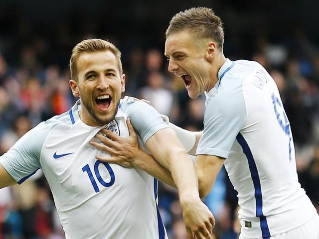 Harry Kane celebrates with Jamie Vardy after scoring the first goal for England.